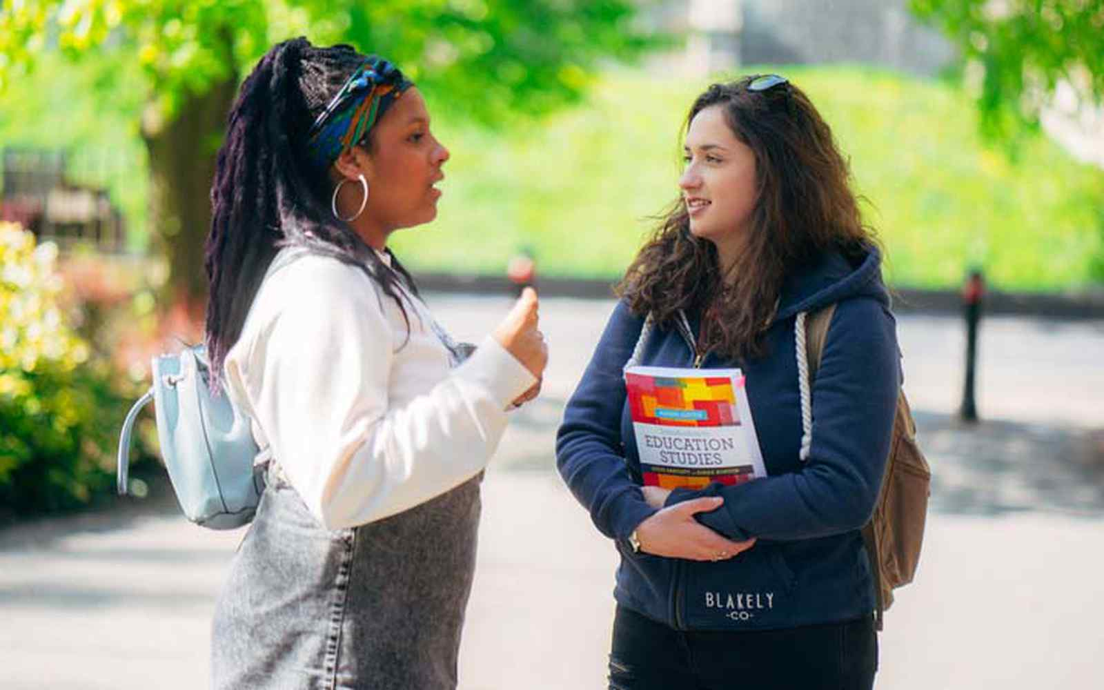 two female students talking outside