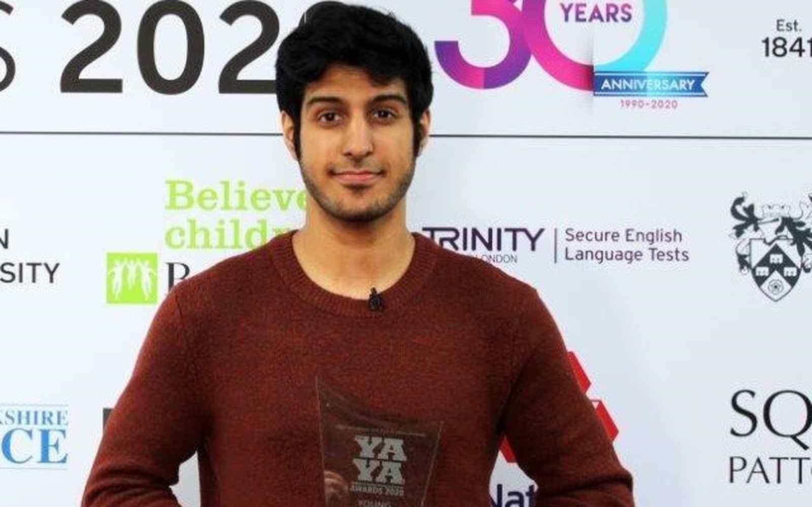 YAYA Awards winner with sculpture trophy in hands