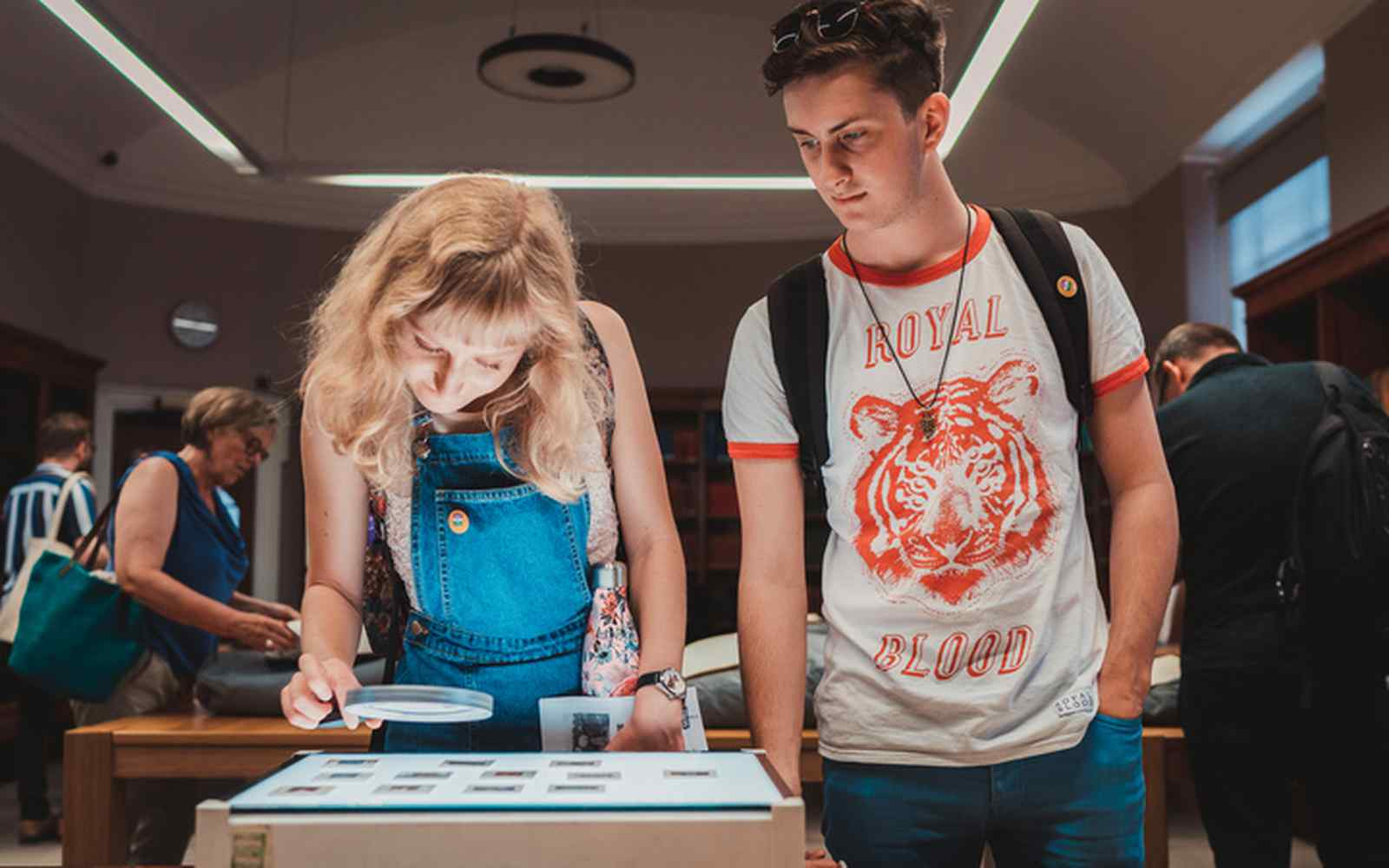 2 students looking at slides on a lightbox