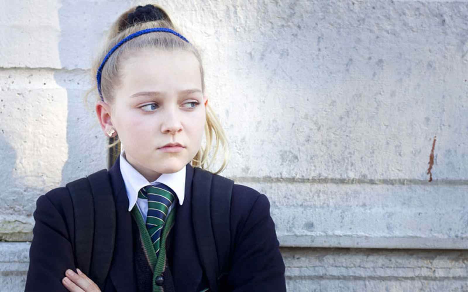 A young schoolgirl looking fearful