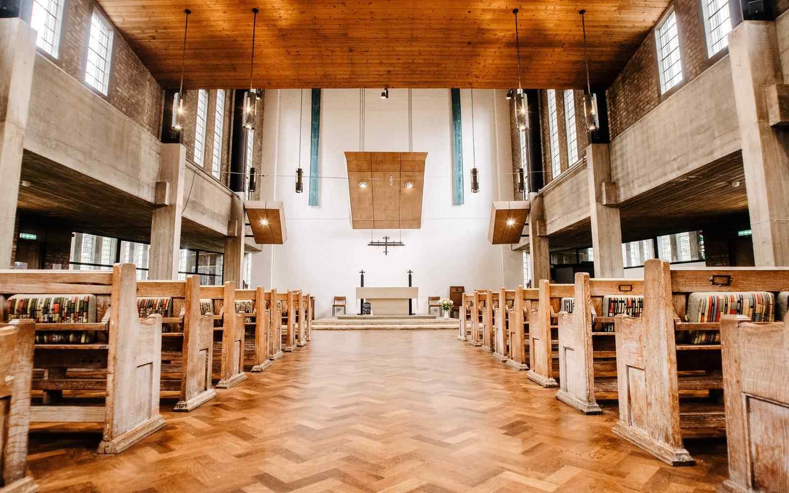 A view up the aisle inside a modern church