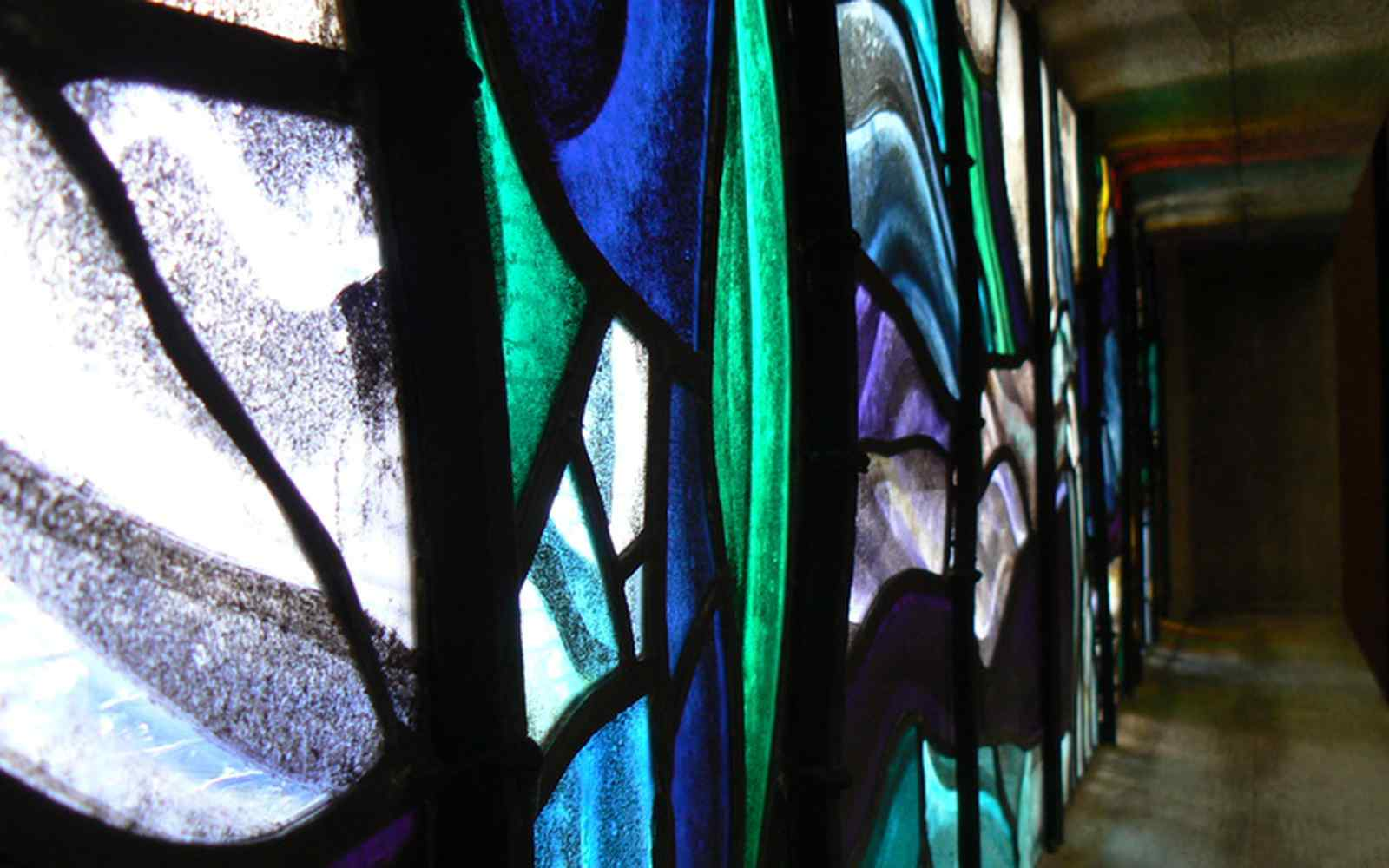 An abstract close up of a colourful stained glass window