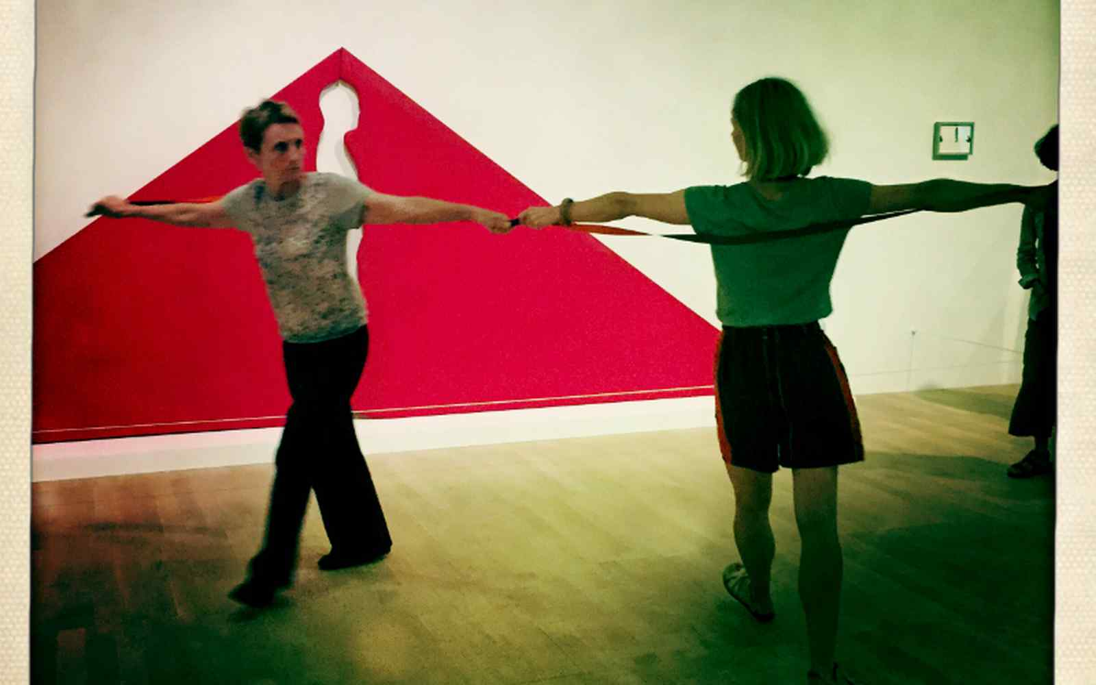 2 dancers in front of artwork at Tate Modern