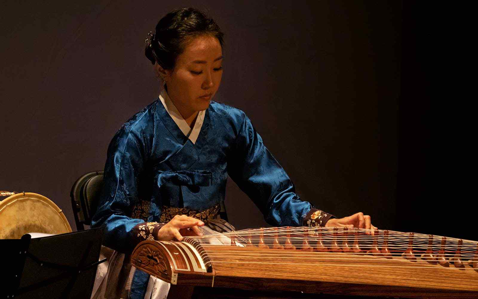 Korean musician playing traditional instrument