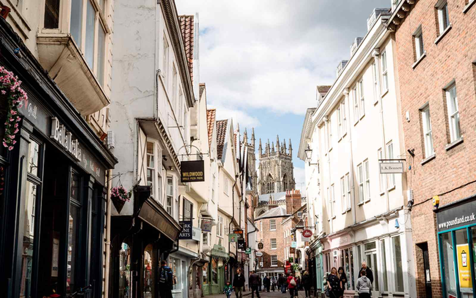 A street of shops with York Minster in the background