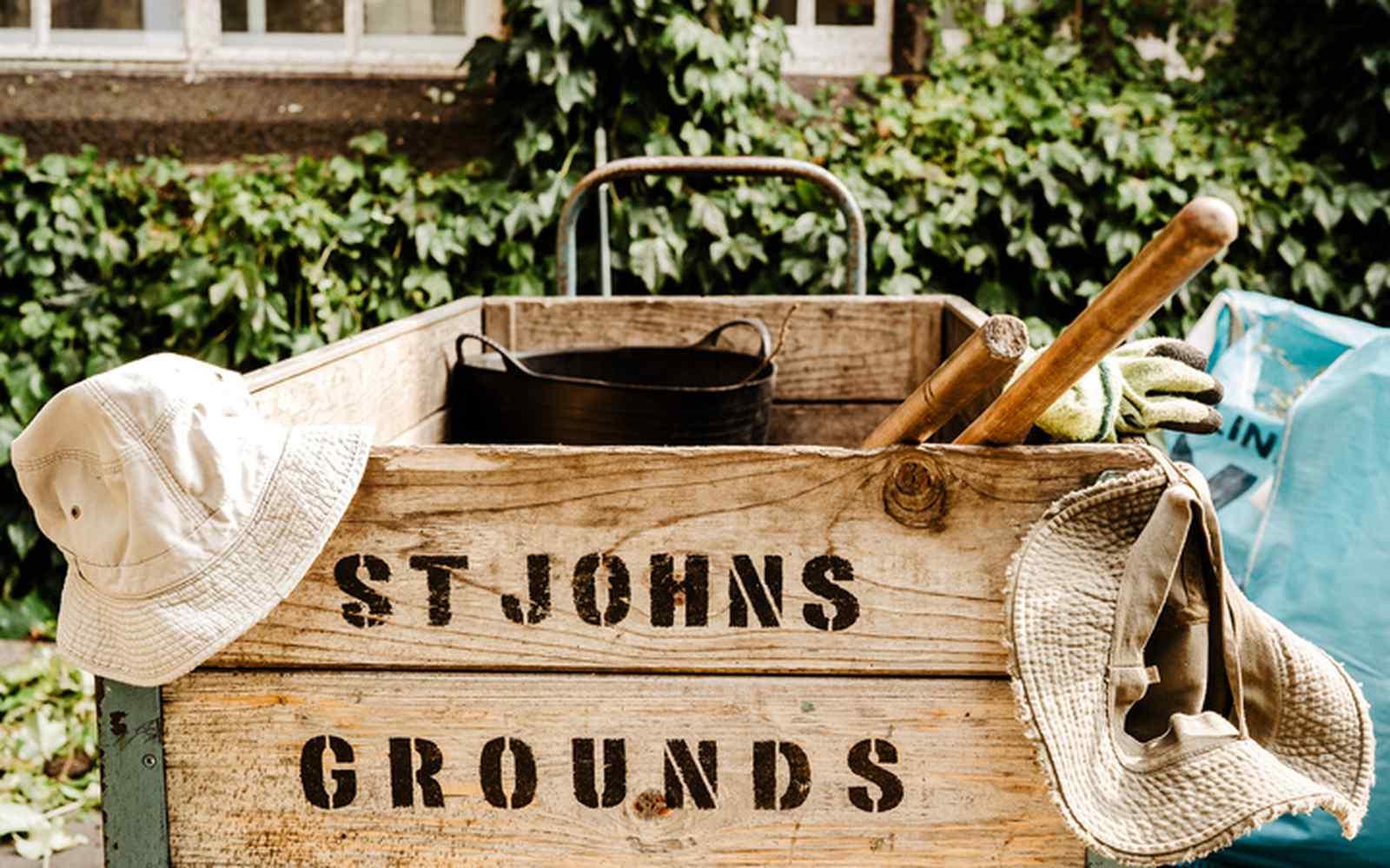 Wooden crate of gardening tools