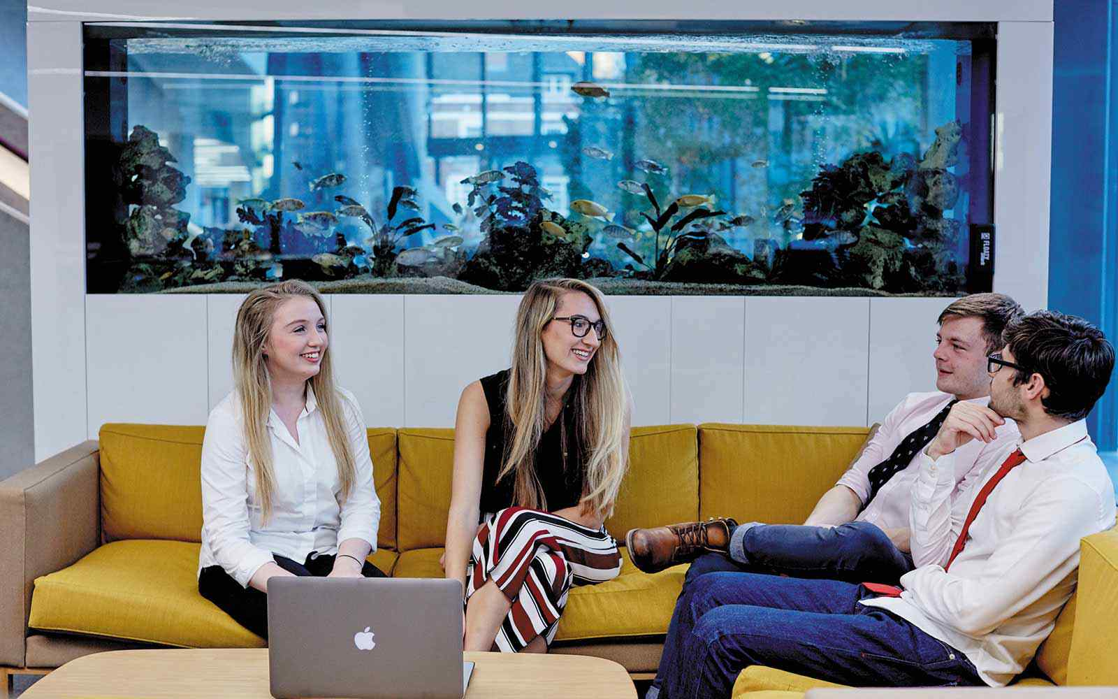 four business students at Hiscox