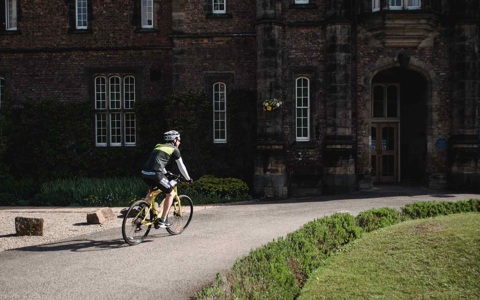Student cycling on campus