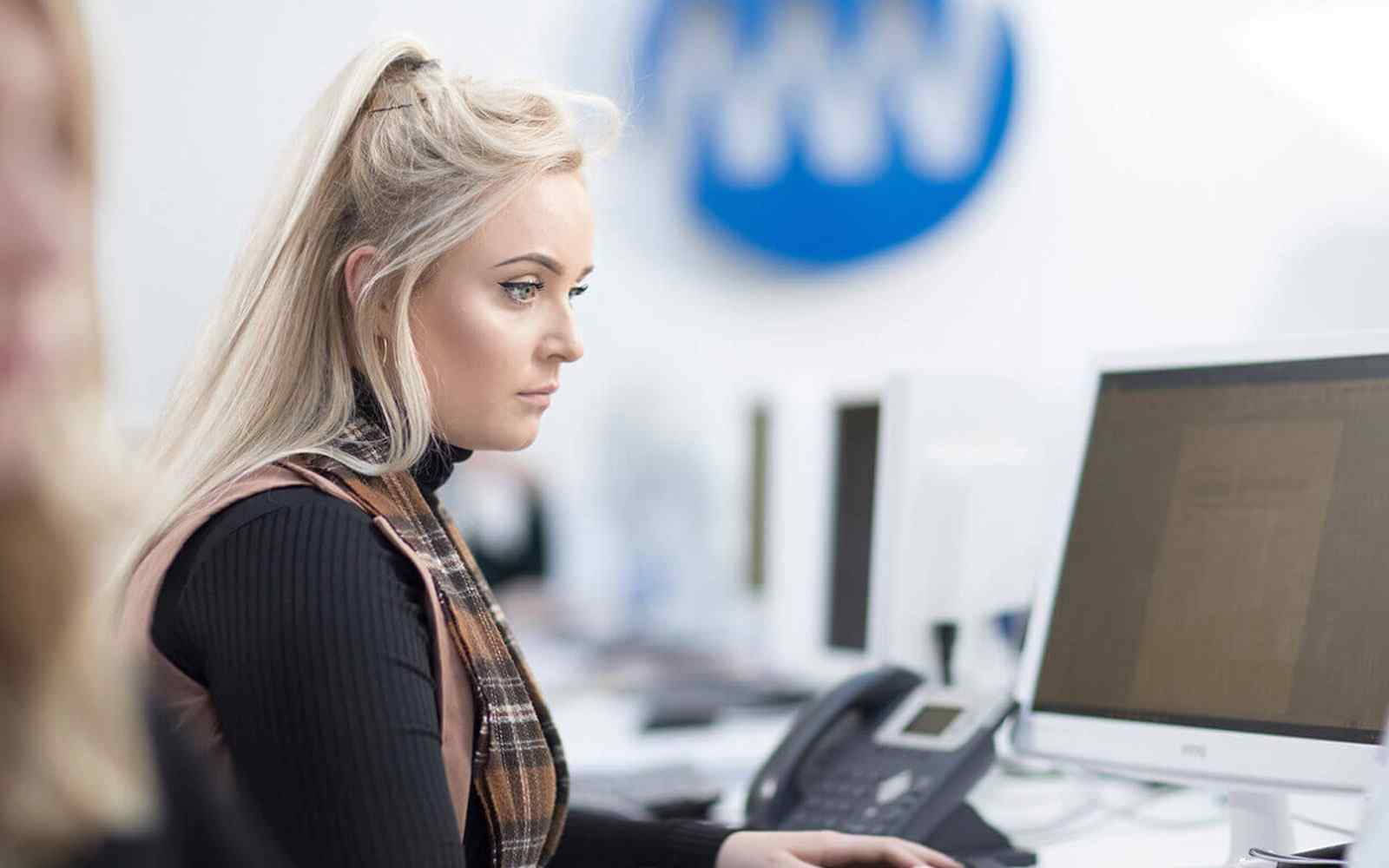 Girl working at a computer in the Media Works offices