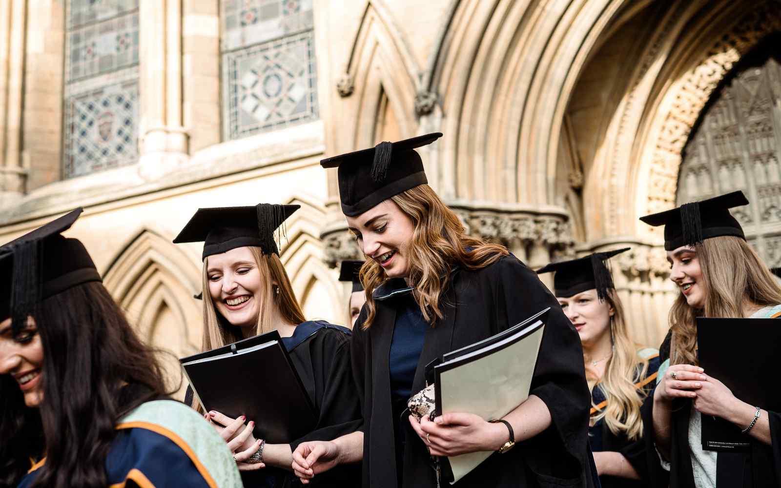 Students leaving York Minster after graduation