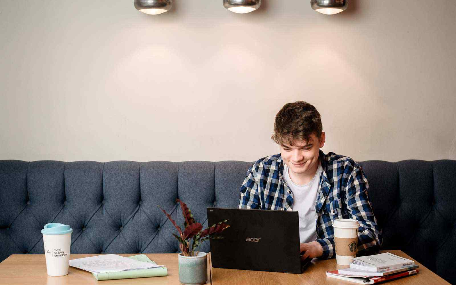 Student sitting and working at a laptop.