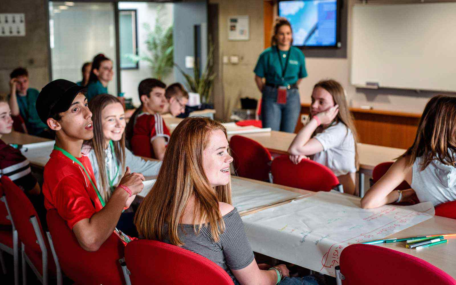Students sit at tables and chat during a York St John event.