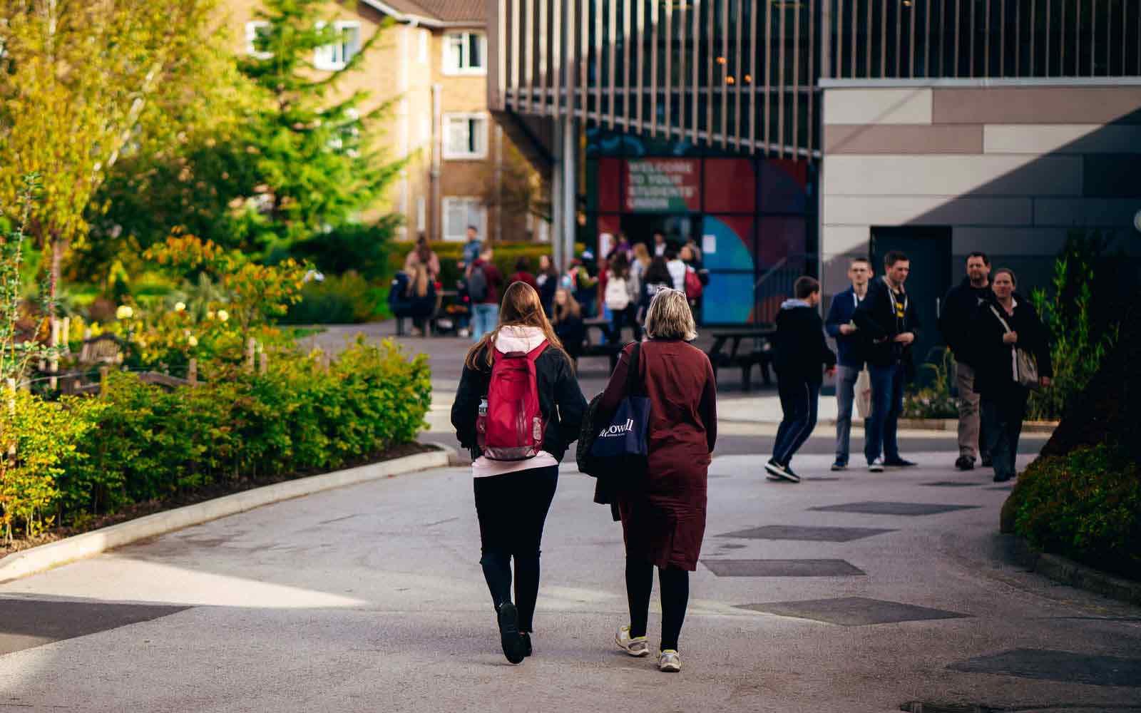 Students walking towards campus building