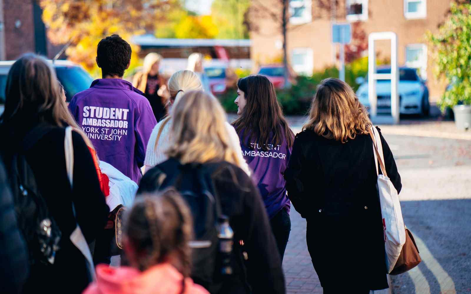 Prospective students and York St John Student Ambassadors walking on campus