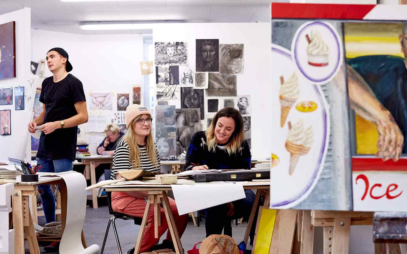 Art and design students working in design studio