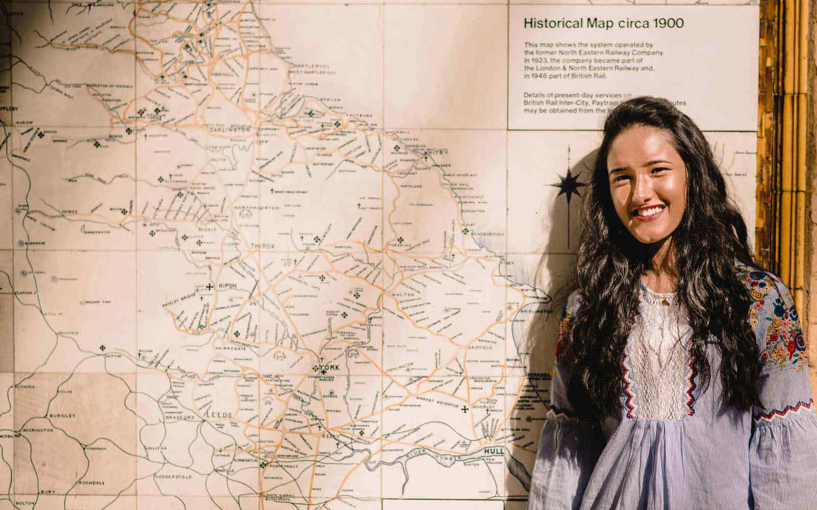 Student stood in front of map of Yorkshire