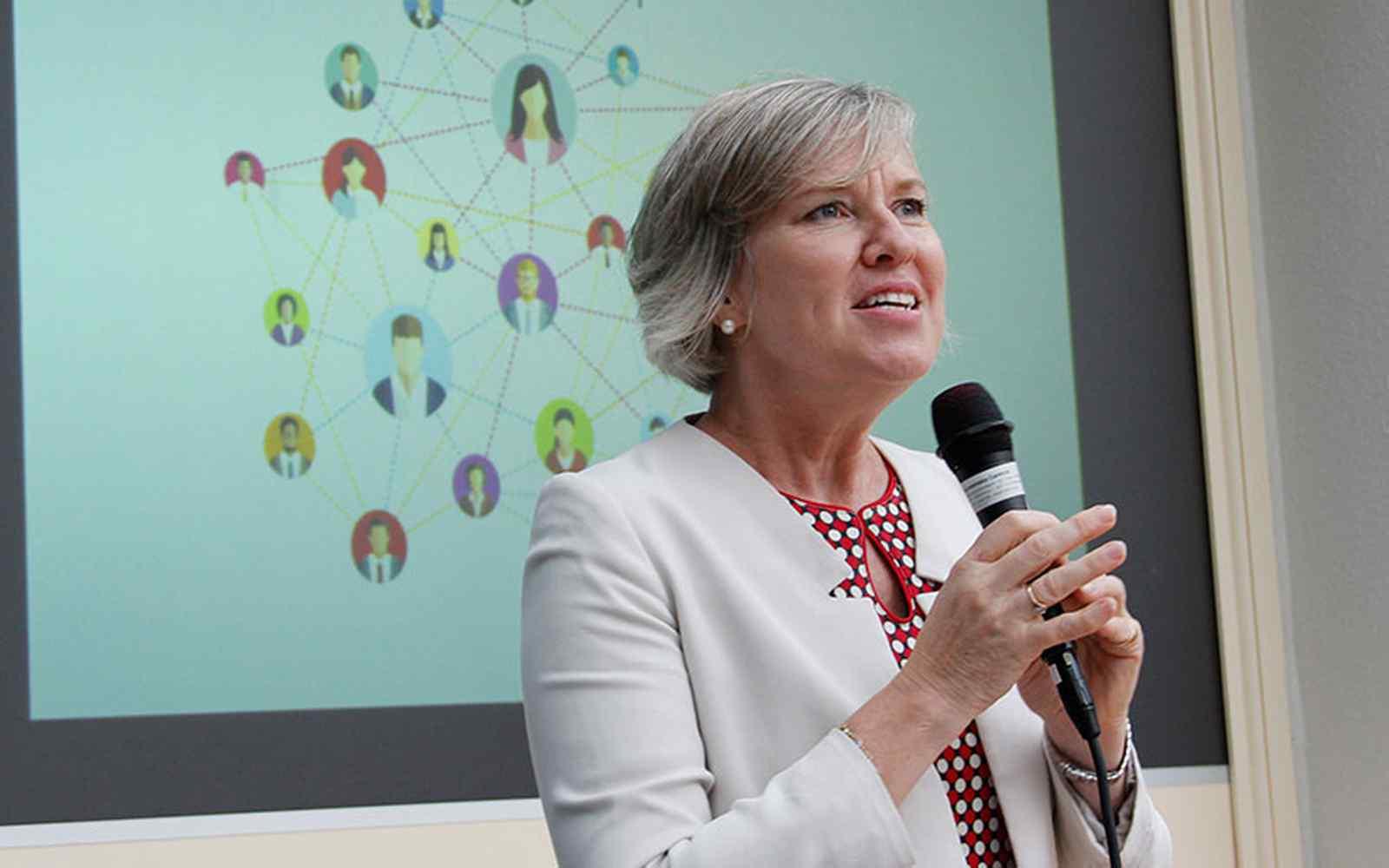 Helen Sworn holding a microphone giving speech