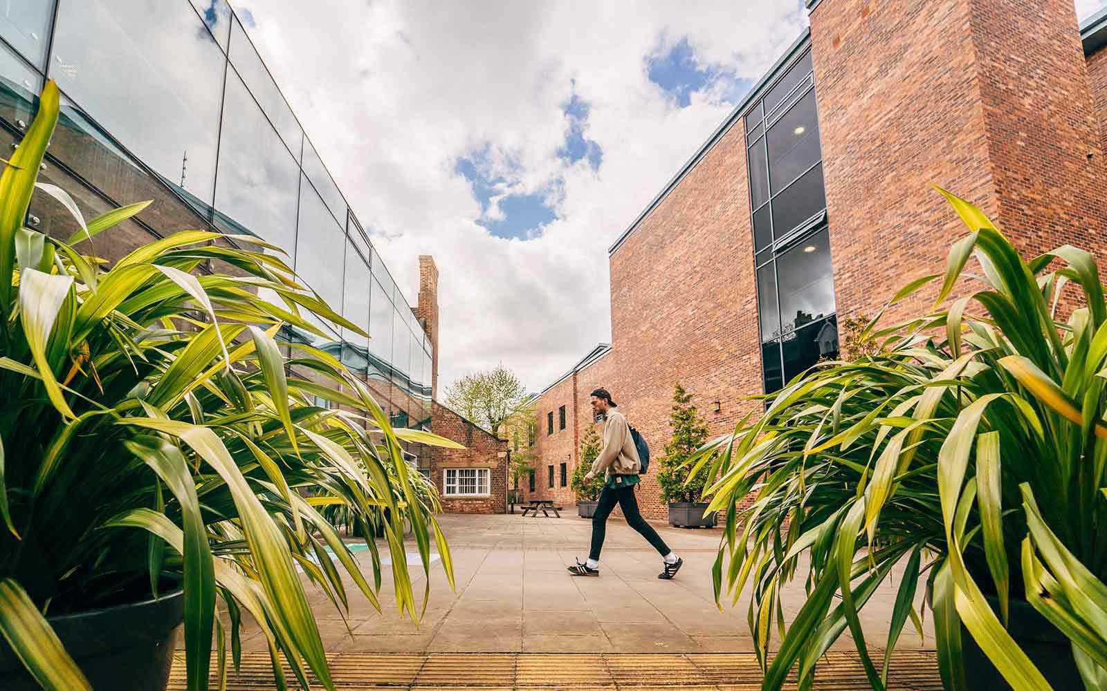 Student walking across campus