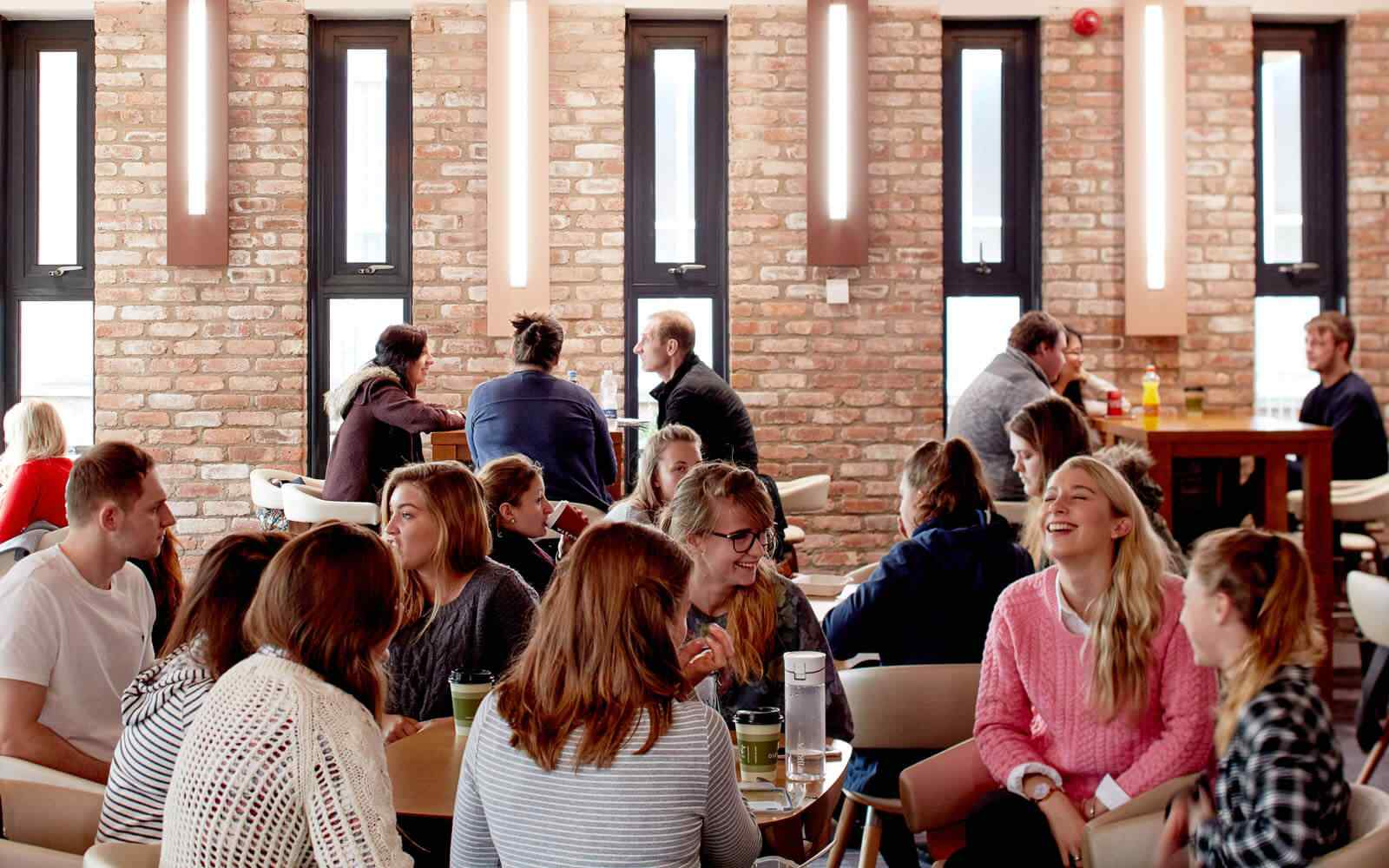 Students sat at tables in main dining hall