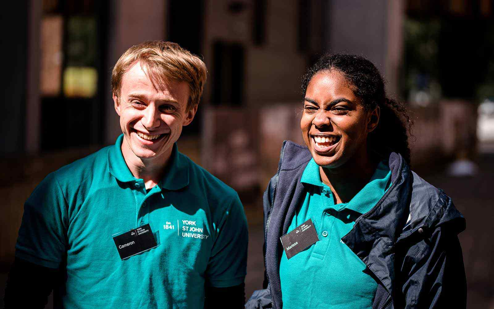 Student Ambassadors smiling at an open day on campus