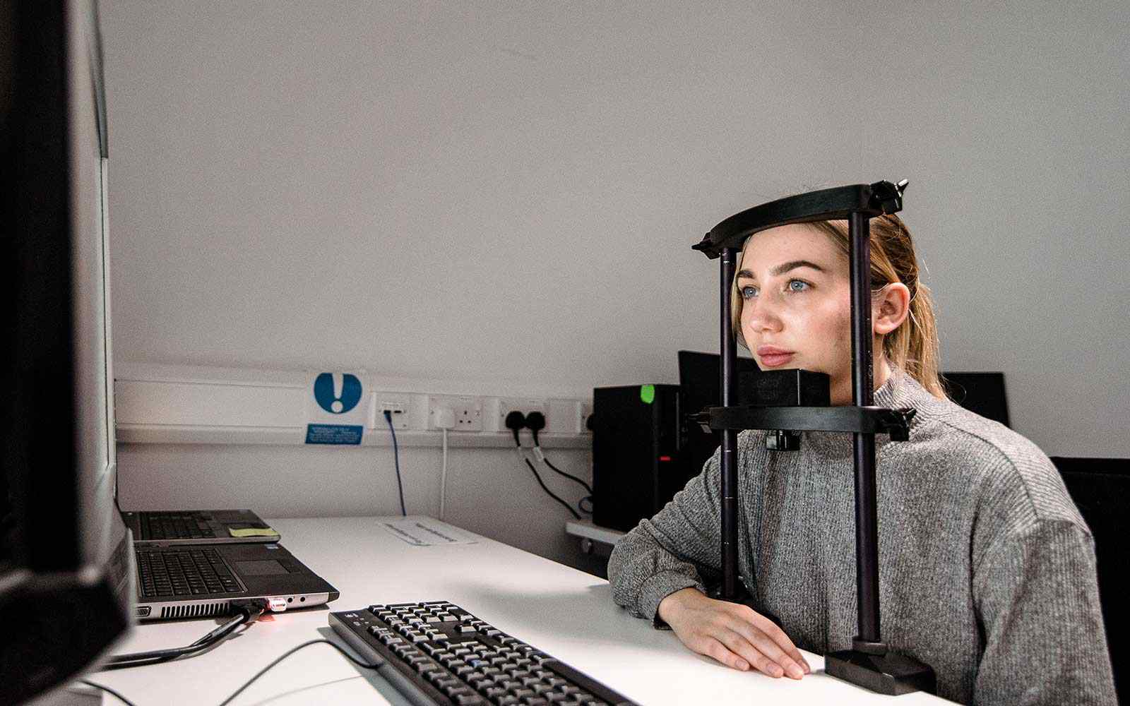 Student using the psychology equipment