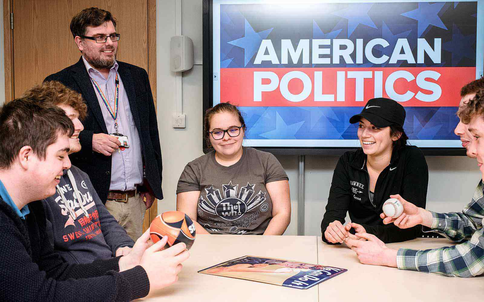 students and lecturer discuss American politics