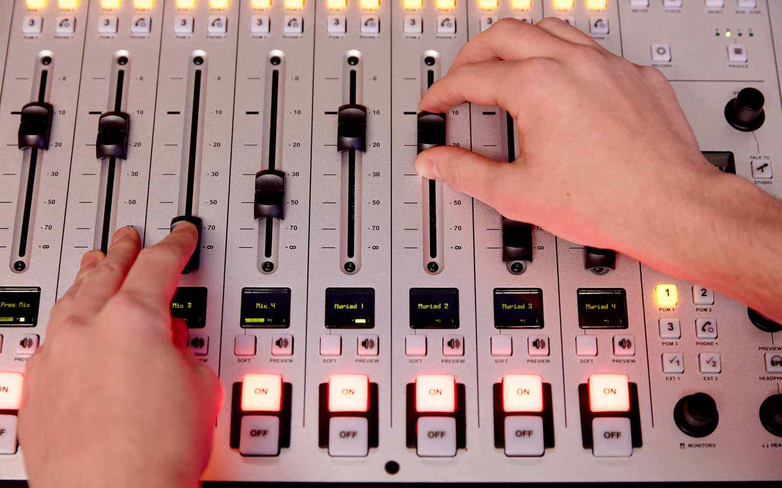 Music Production student using sound desk