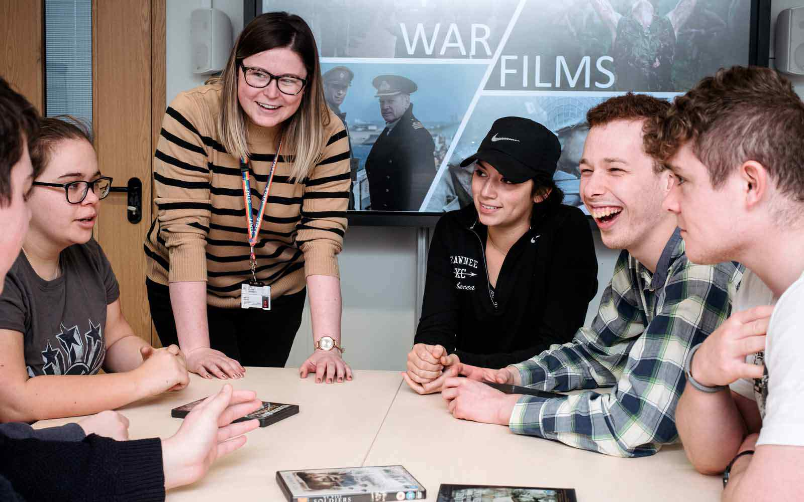 Student discussion around table in war films seminar