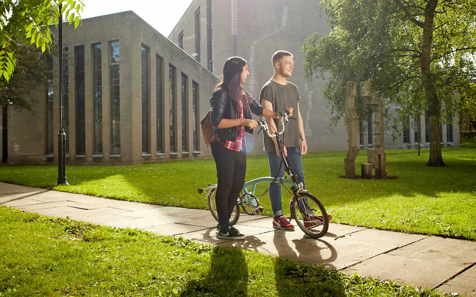Students walking on campus in the sun