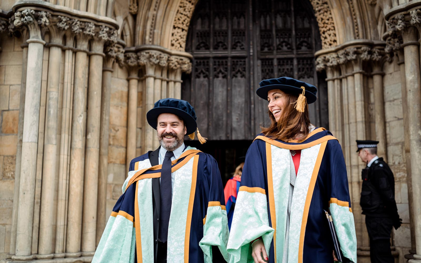 Honorary graduates walking out of the minster