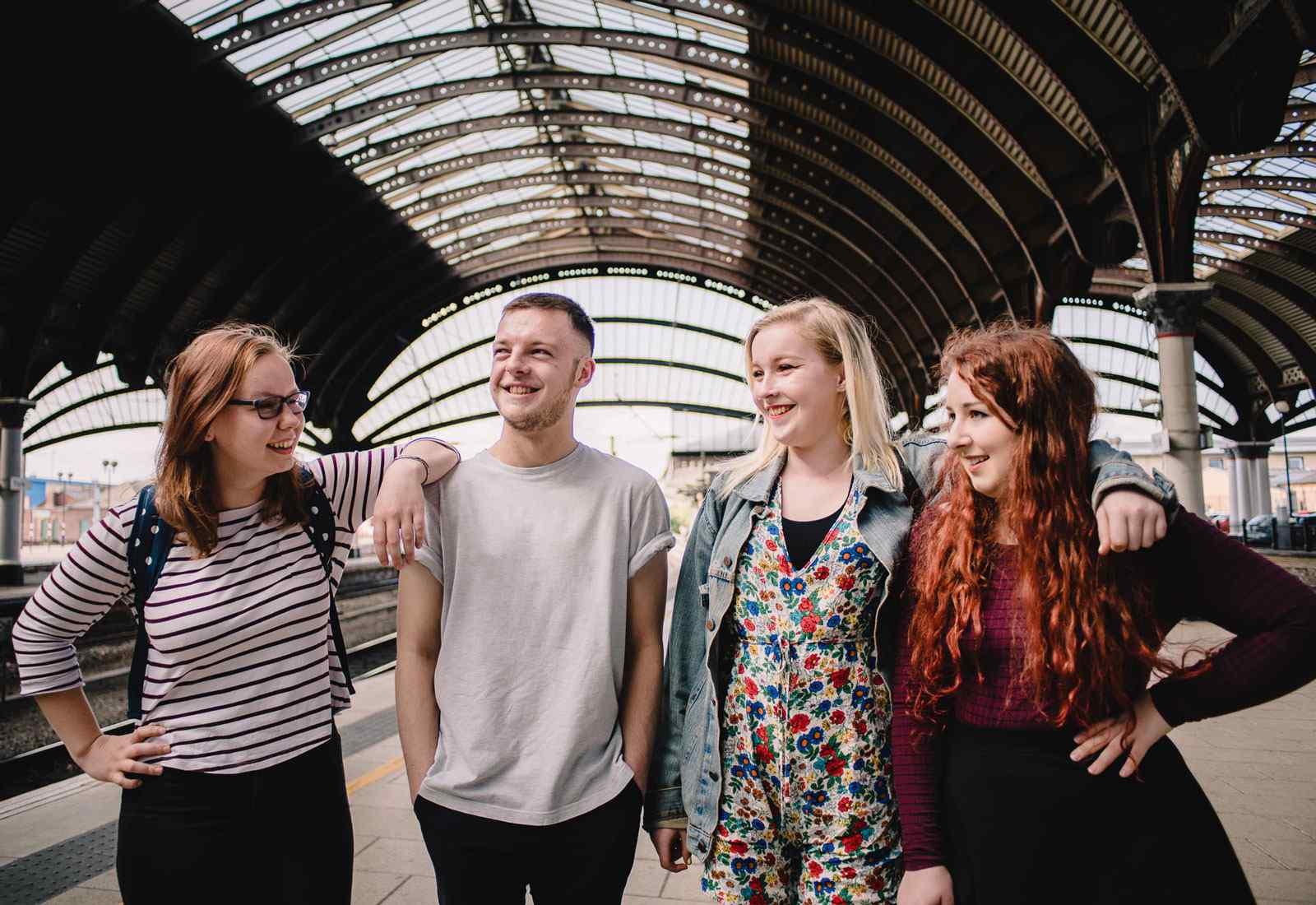 Happy students at York train station