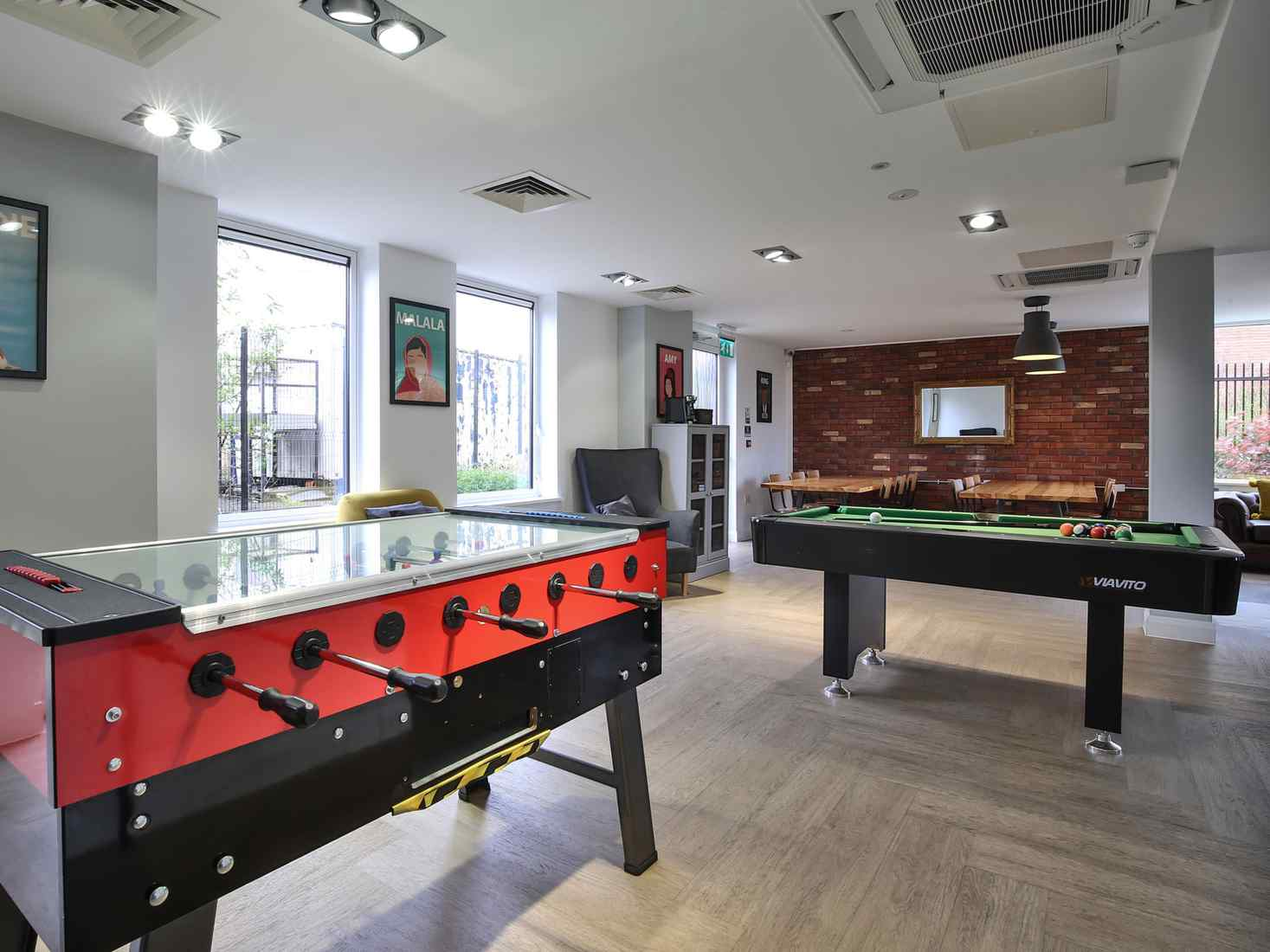 Social space at the Brickworks, with a table football table and a pool table.