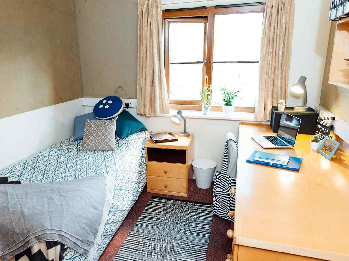 Student bedroom in Limes Court with bed, desk and side table