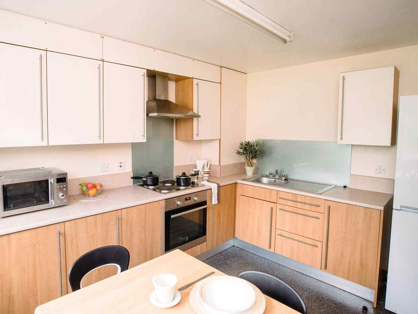 Student kitchen with dining table