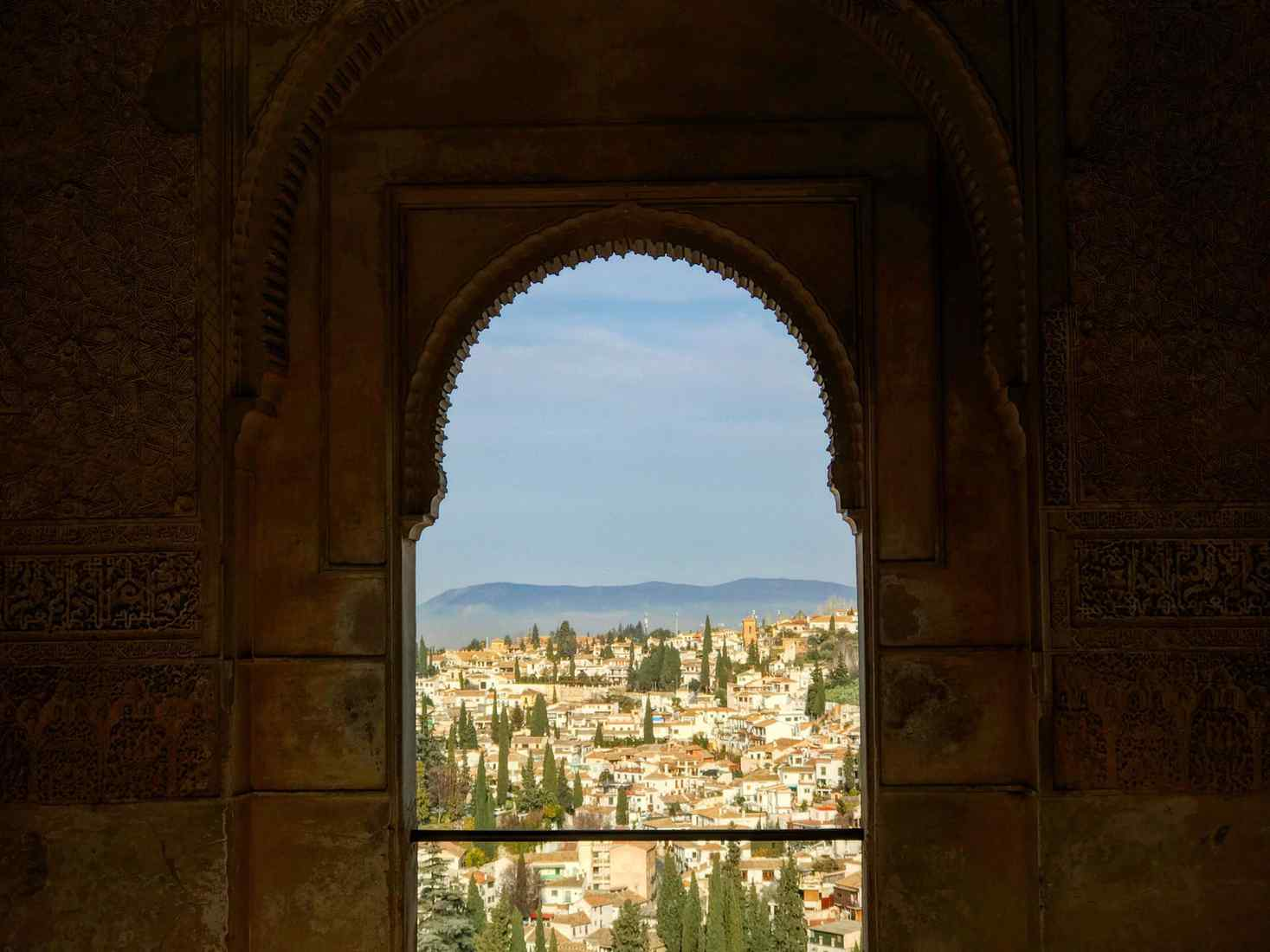Looking through a window over a town in Andalusia, Spain