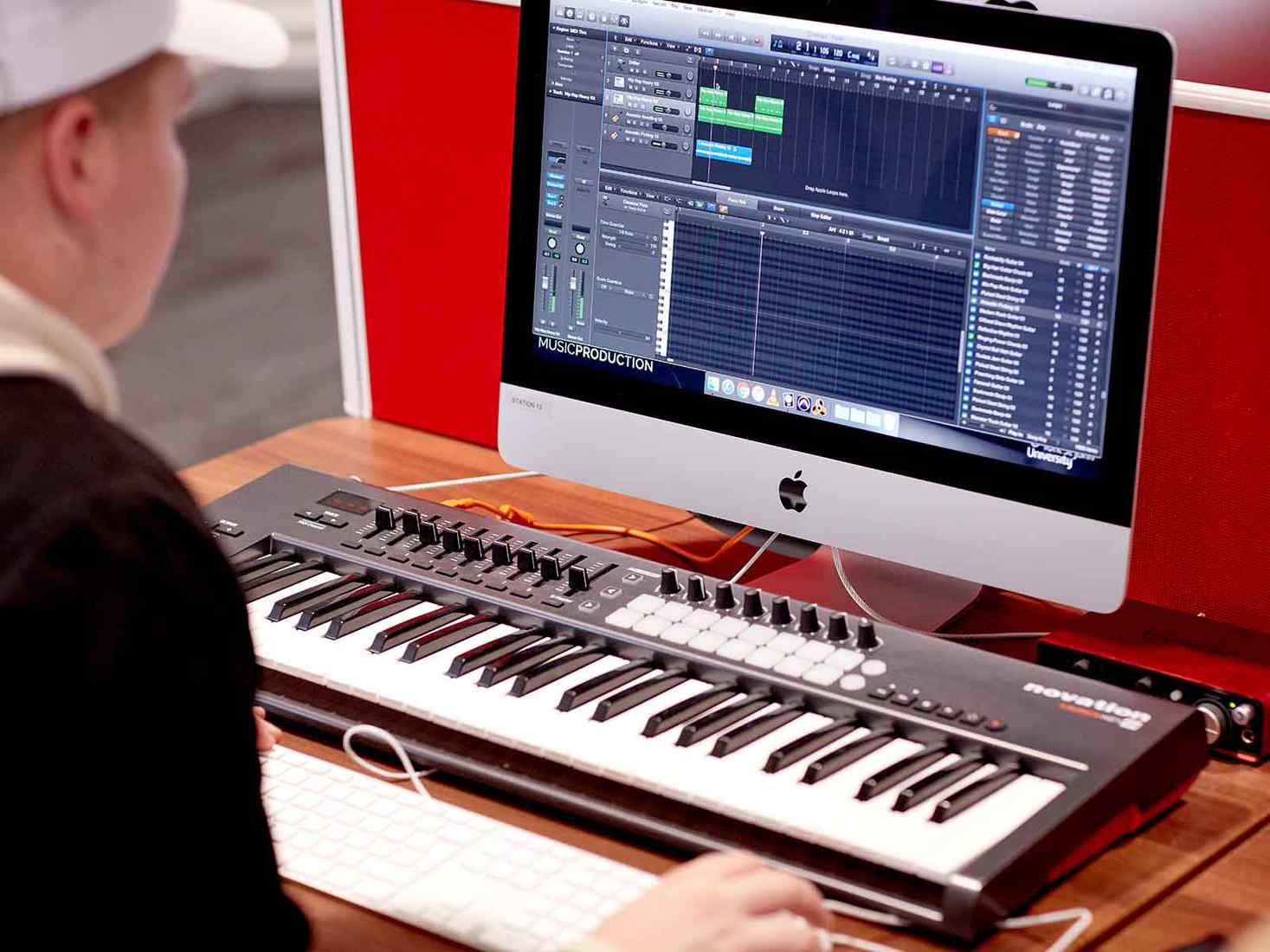 student looking at digital music work