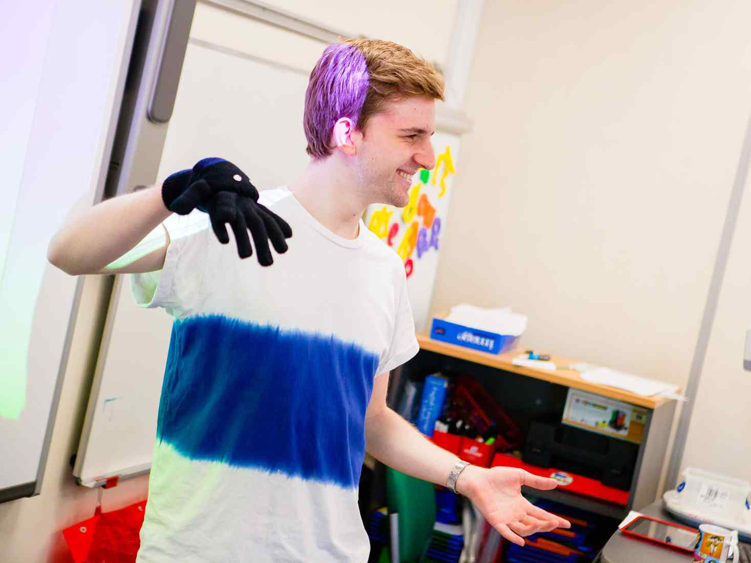 Student using hand puppet
