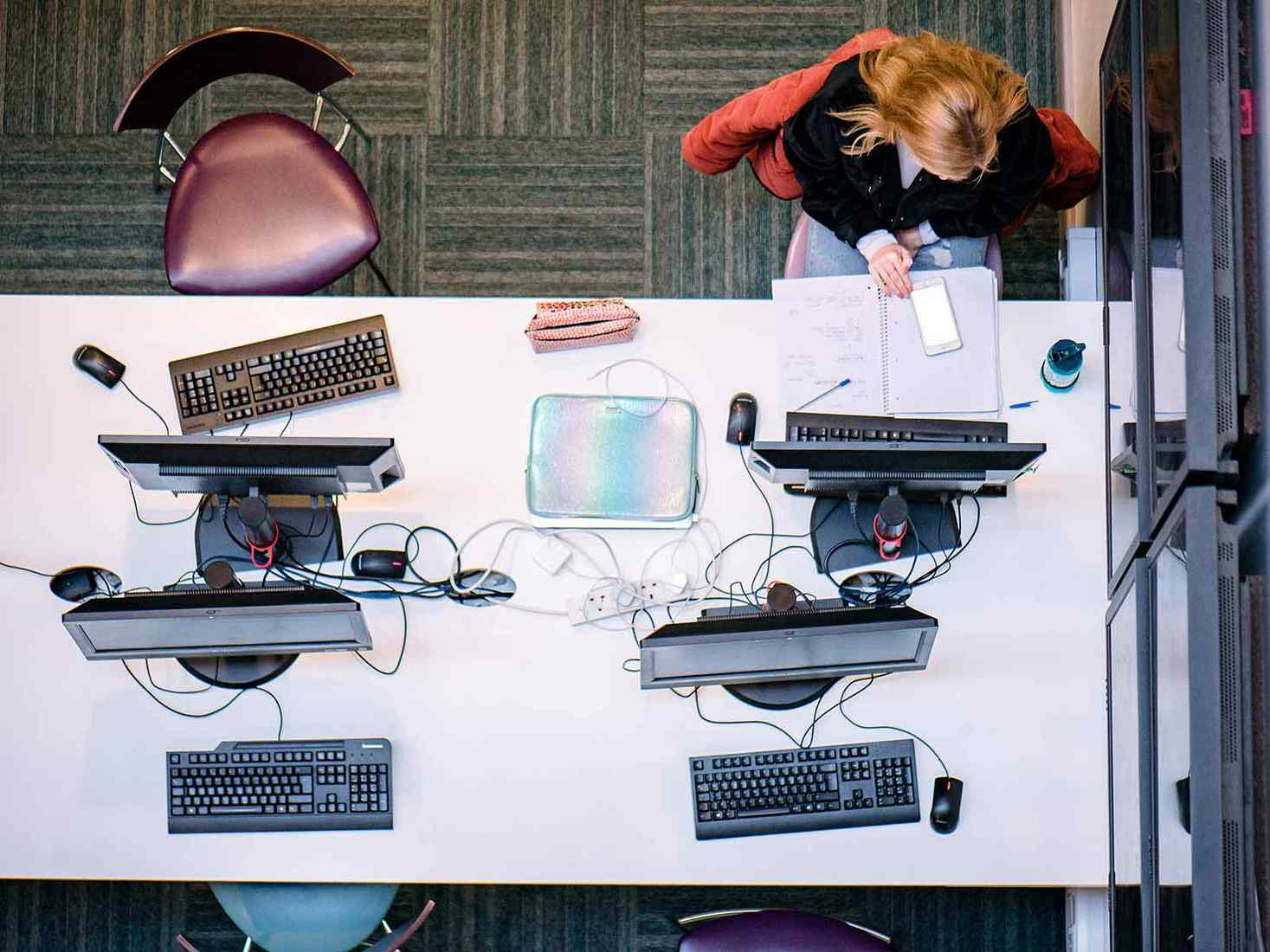 birds eye view of the computers and students heads with work