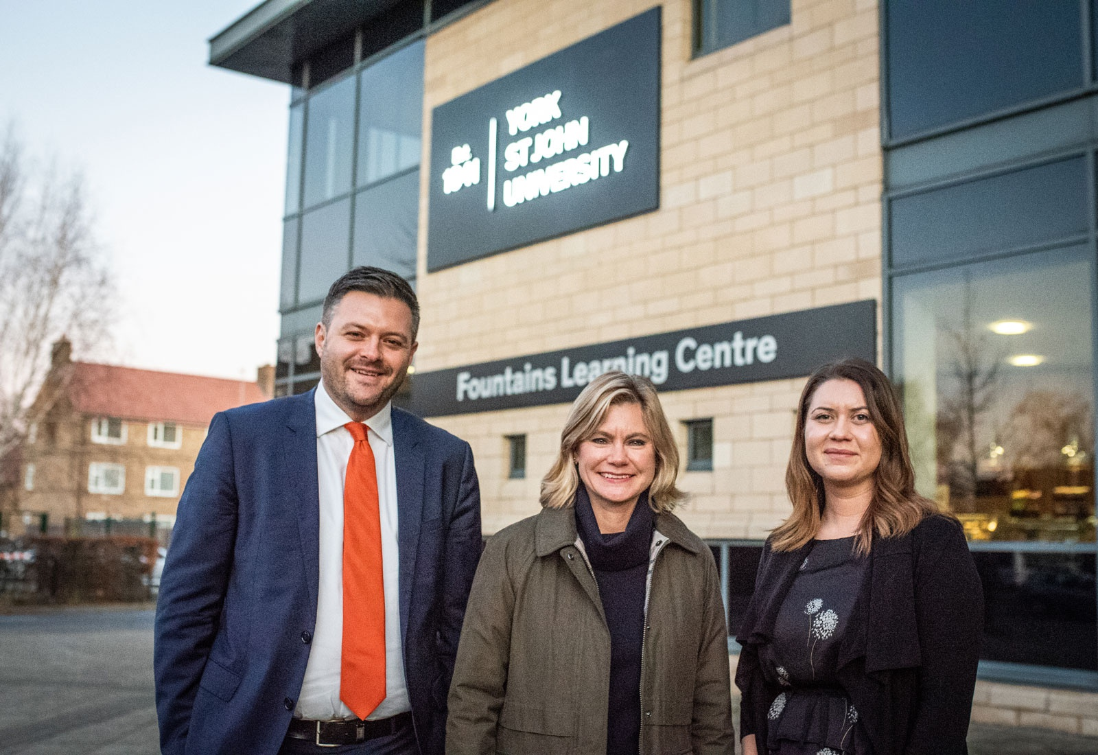 Rob Hickey, Justine Greening and Eleanor Ineson standing in front of York St John University.