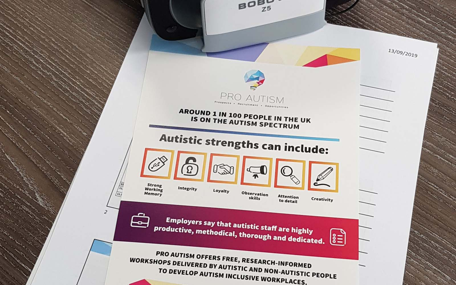 Pro Autism leaflet on a desk