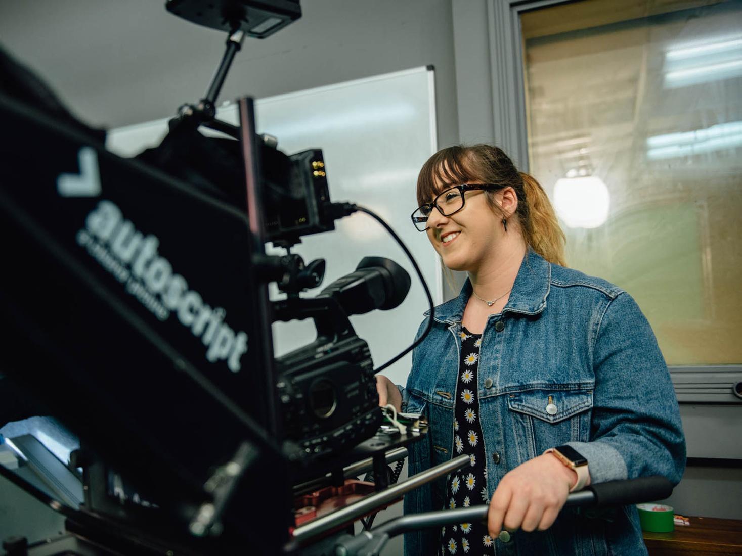 Student using film camera