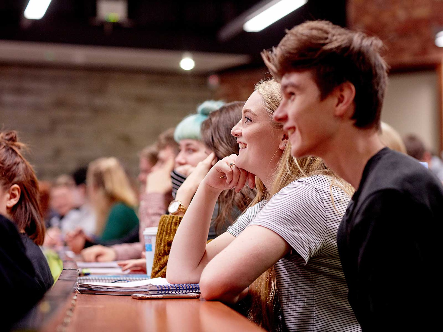 students in a lecture. They are smiling