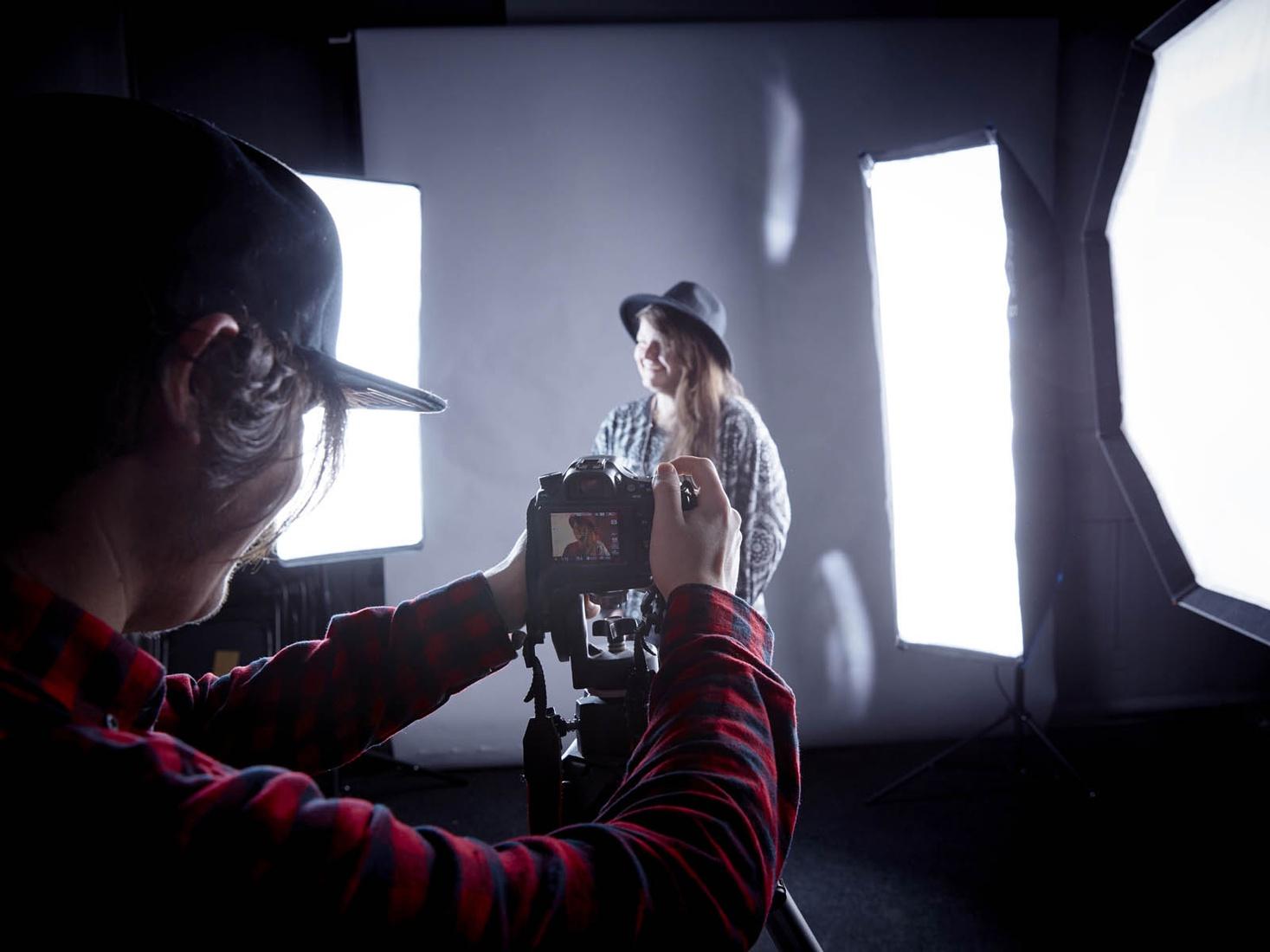 Student taking photo in studio