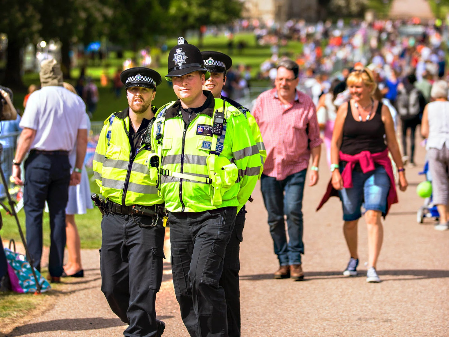 Police officers walking down busy pathway