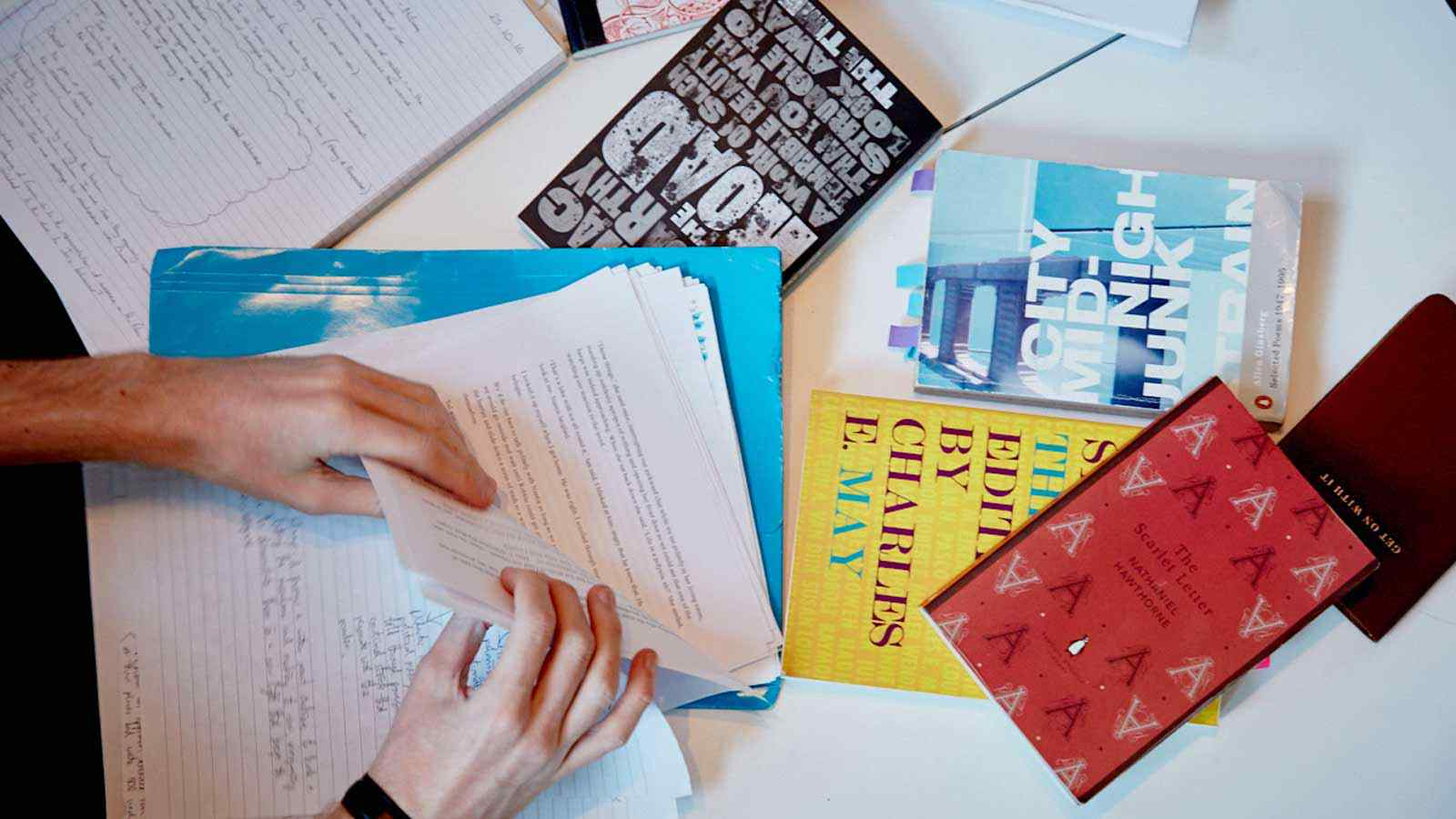 English literature texts and student notes on table