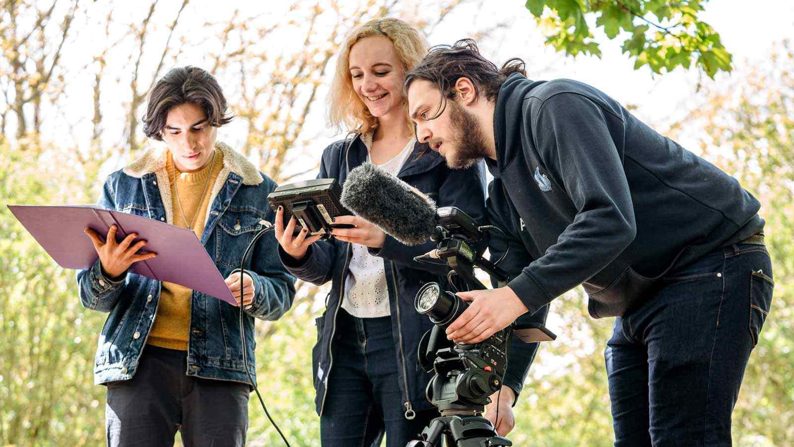Students using film equipment outside