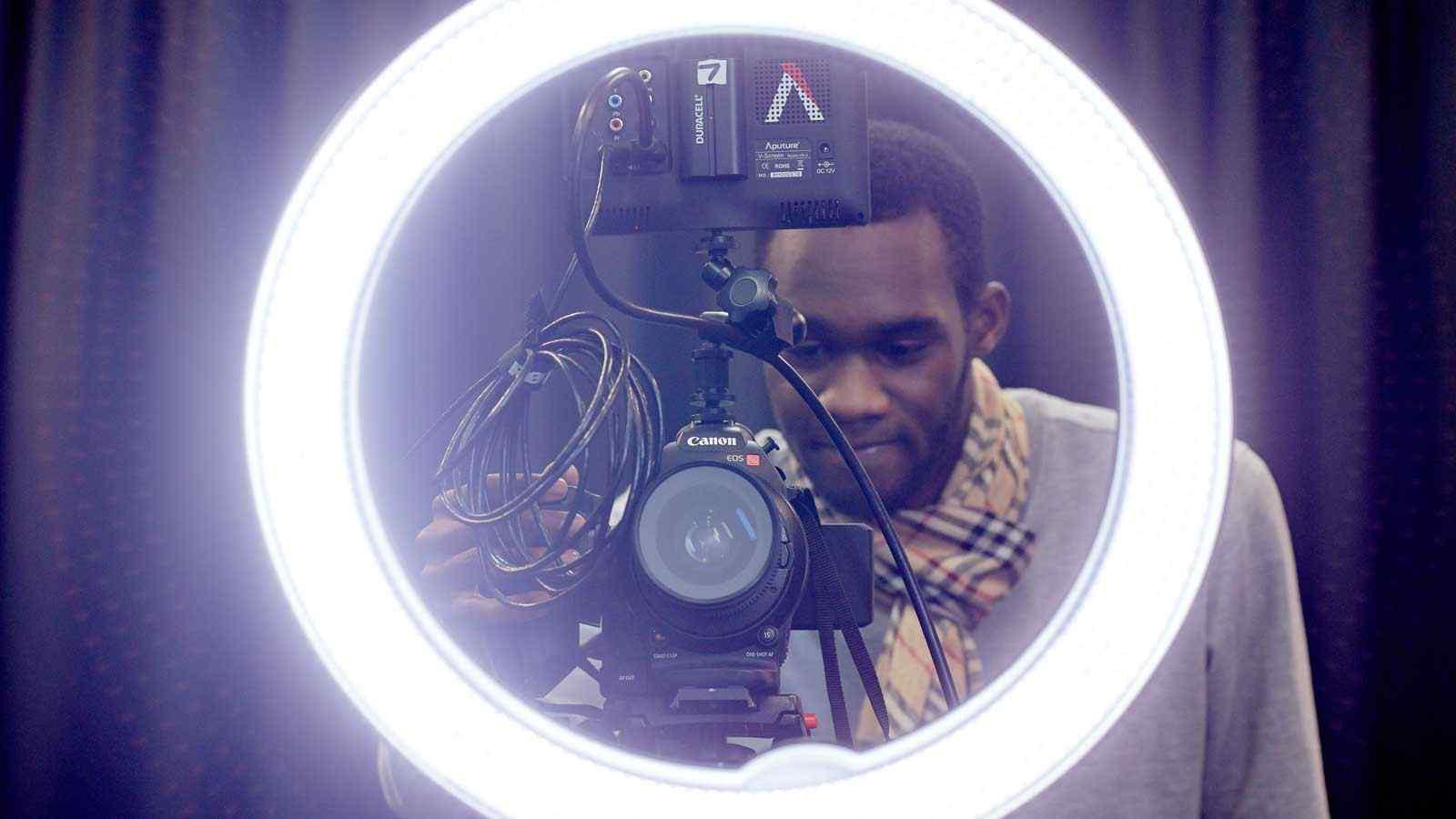 Student taking photo through ring light