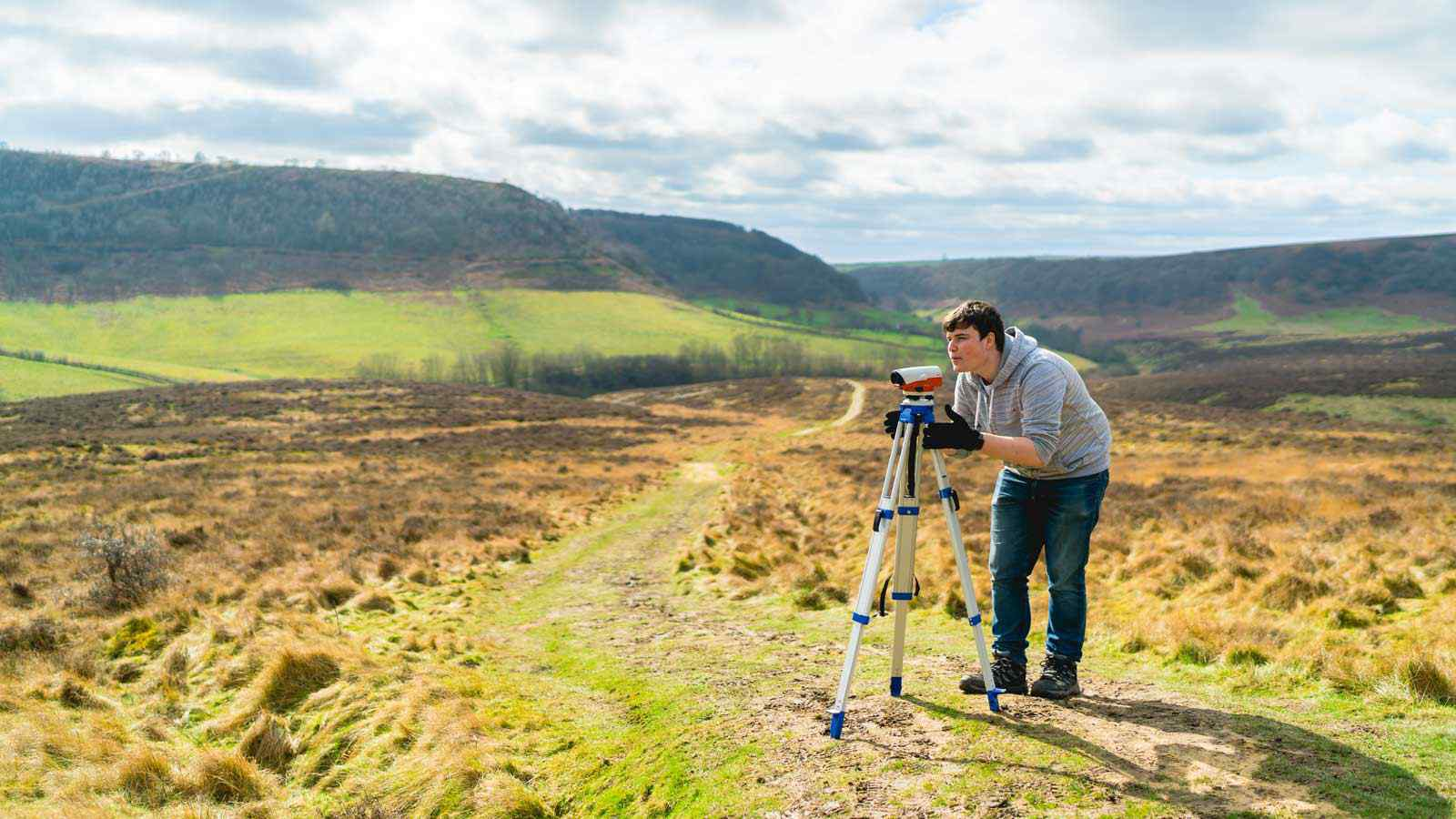 Student using equipment on geography field trip