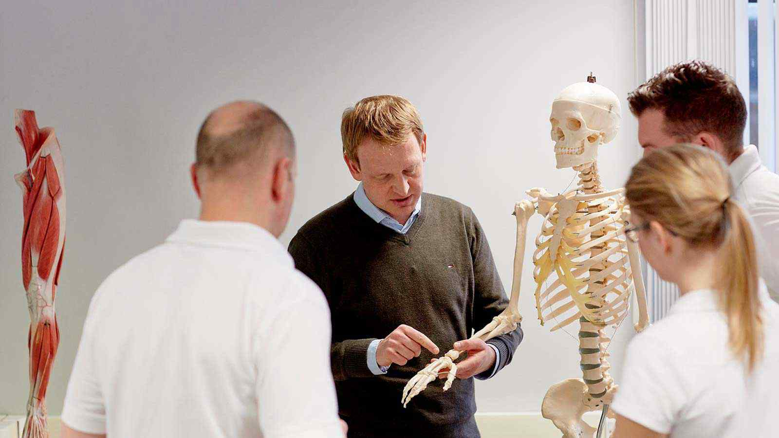 Lecturer using skeleton model in lecture to class