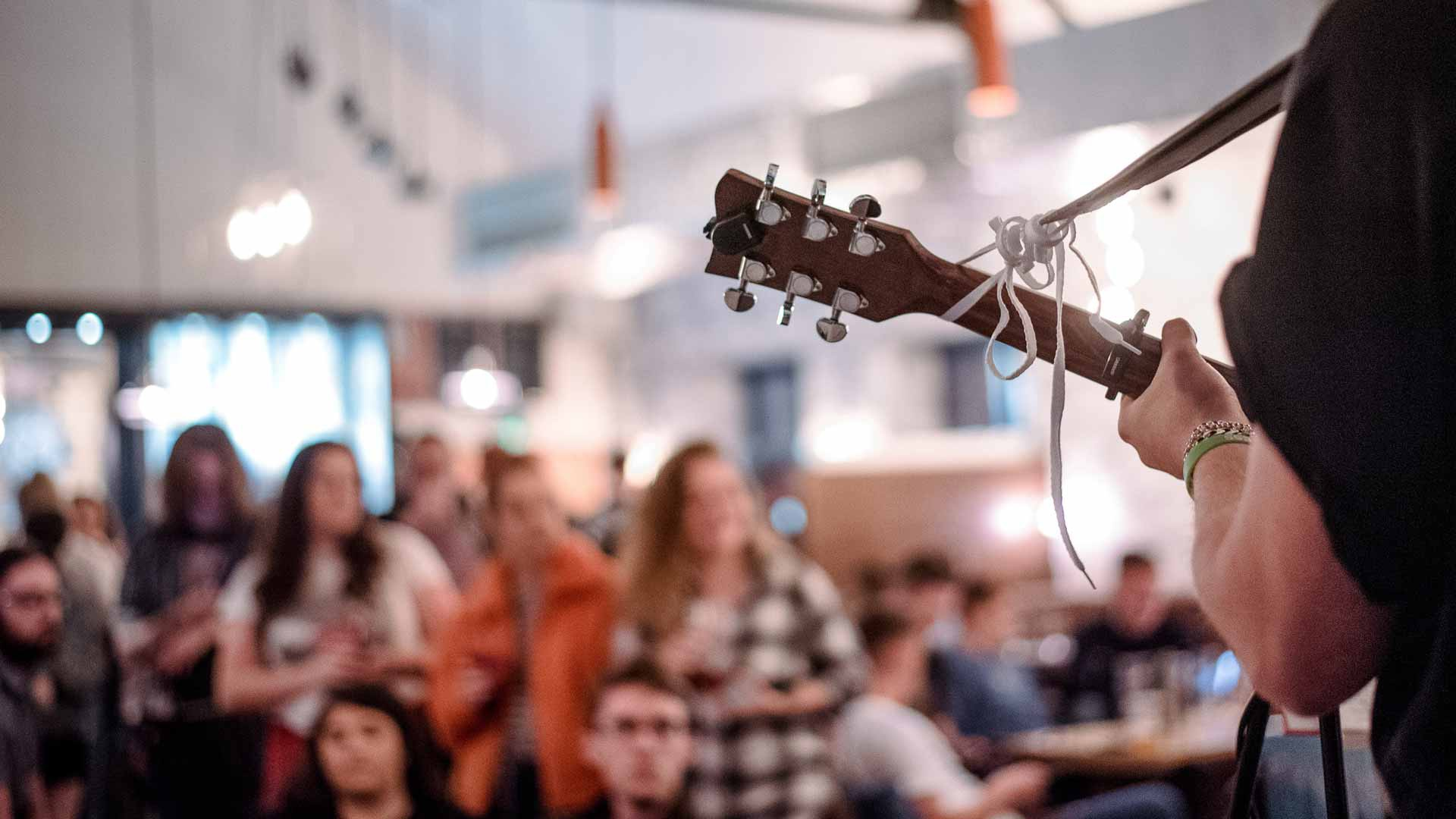 Students listening to live music in the Students' Union